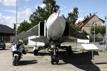 Posing at aircraft museum Wernigerode (Germany) with a Mig23