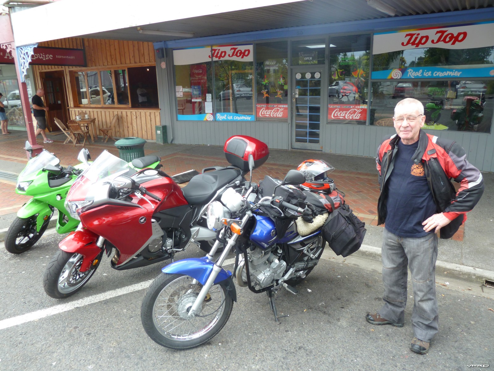 Old timer touring on 225cc Yamaha
