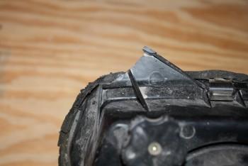 broken tab on headlight