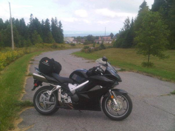 My bike with Foymount in the background - Foymount hosts an abandoned Cold War radar station, and boasts the highest inhabited point in Ontario (484m above sea level according to my GPS app....)