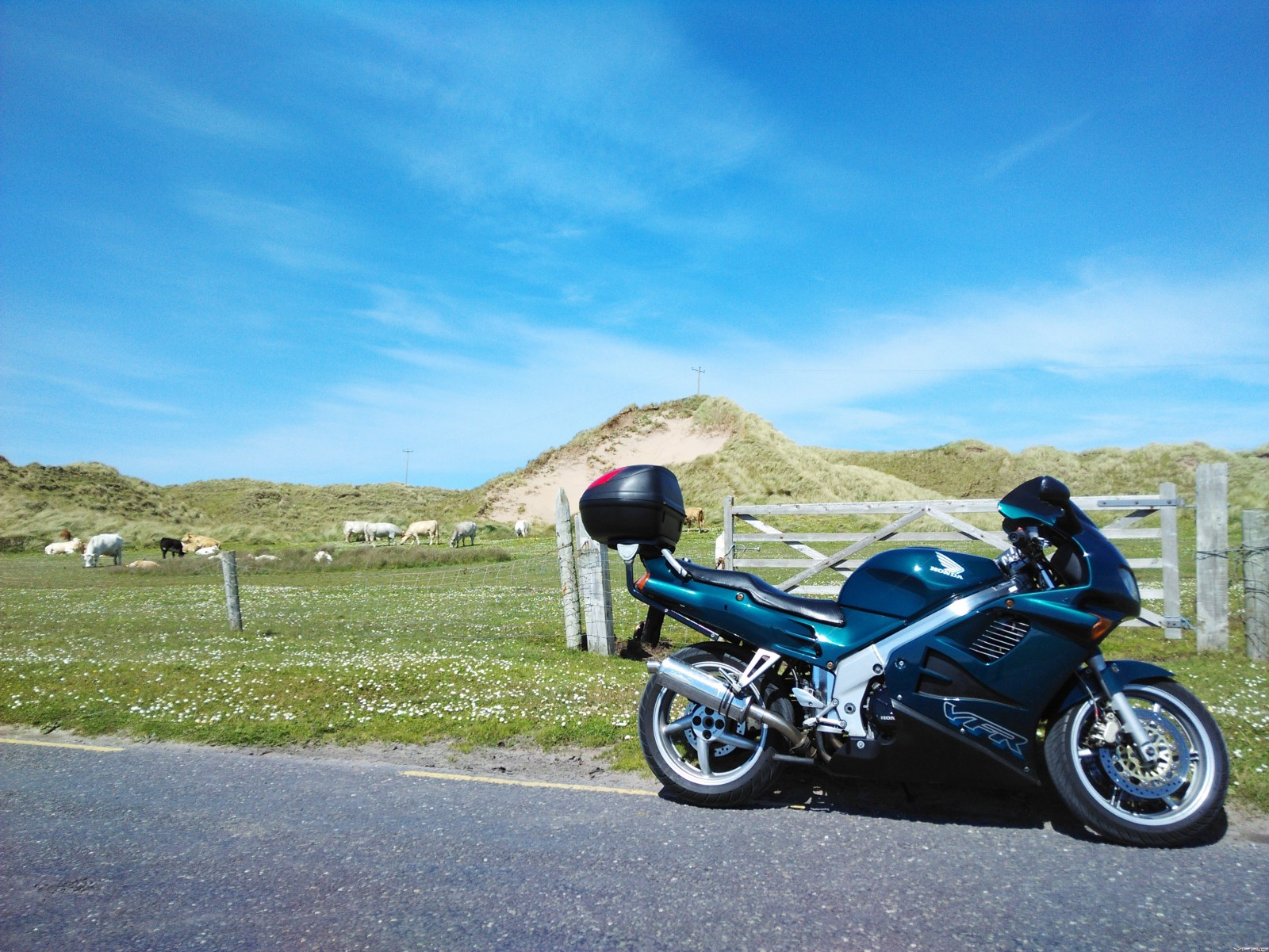 Blue sky, sand dunes, and a green RC36