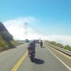 Golden Gate Bridge peaks above the fog.